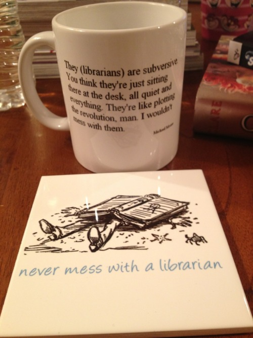 "earthinmywindow:  Mug and coaster, a late birthday present from the awesome librarians at the hospital library where I volunteer on Fridays. They said it was ""indoctrination,"" to which I had to reply that I am already flush with librarian pride and will proudly to bear these badges. I seriously love being a librarian."