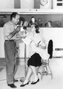 redguitarrr:  Humphrey Bogart and Lauren Bacall at a radio station, 1952. Photographed by Sid Avery.