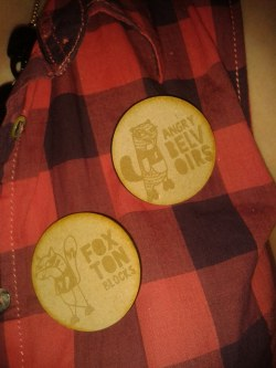 Our gorgeous sold-out limited edition intraleague badges!  They're wooden, and feature team logos for Foxton Blocks and Angry Belvoirs.  Look out for the Undercover Meerkat badge soon!