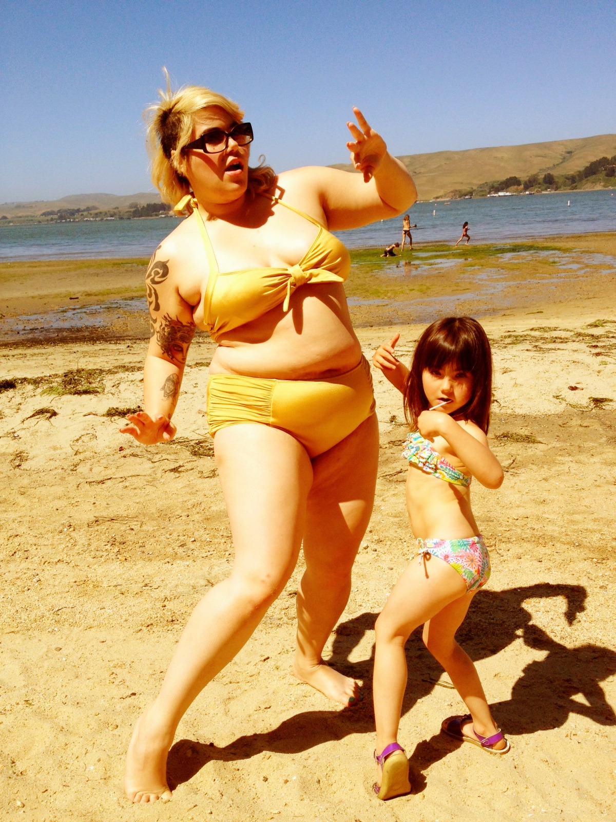 dirtynerdycurvy:  My daughter and I had a beach party. I played records and we did the twist in our bikinis.  Bellies are awesome!