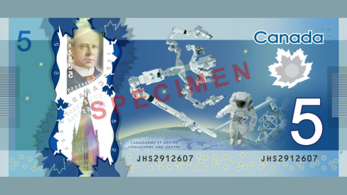 "Canada unveils its sweet new space-themed $5 bill in space  ""With the help of Commander Chris Hadfield aboard the ISS, the Bank of Canada yesterday launched its new robot- and astronaut-themed five dollar bill. Hadfield had been keeping the new bill under wraps for months.            The new polymer $5 bill shows the Canadarm2 and Dextre manipulator robots, along with an ambiguous astronaut meant to symbolize all Canadians who have contributed to its space program."""