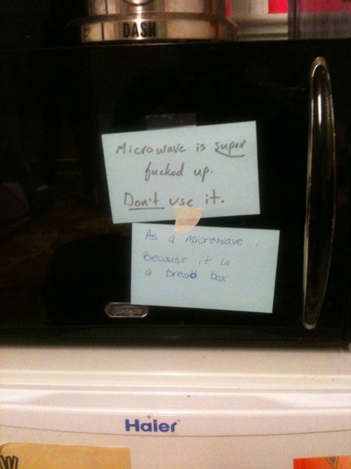 girlsof310:  **UPDATE** Our broken microwave is now sporting a new sign claiming its new occupation as a bread box