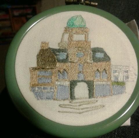 Here is my weekends embroidery (Yes, I do say that like I regularly complete embroideries in a weekend). This tiny hoop is of the Central Hall on Old Market in Bristol.  Central Hall was built in the 1920's and converted into flats in the 1980s.  Its one of my favourite landmarks of Bristol because I often find you can spot its tower on the skyline from all sorts of locations.  The source image I used was from when it was out of use and prior to its conversion into flats.  As a result the tower is still open to the elements. I'm slightly dubious about the blues of the windows (I had to improvise a bit as in the source image all the neighbouring buildings -save the punchbowl which is just cropped off- were vacant and boarded up).  So I will probably assess it for a few days and then consider adding frames or something to break up all that blue. This teeny hoops is the first in a collection of three Bristol landmarks.  Who knows I might have another to share next weekend!