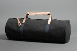 draughtdrygoods:  Draught Dry Goods / Getaway Duffel in Unwashed Denim w/Heavyweight Camo Cotton Interior / Now Available This pattern has gone largely unchanged in 3 years.  I designed it to hold one million dollars in cash, and that's why its named The Getaway Duffel.  I've literally never see 1M in cash, but if you have that sitting around and can verify my measurements I will send you one for free.