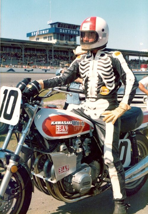 "Dave Aldana sporting the bones leathers aboard a Yoshimura Kawasaki Z1. Alongside the red A on his helmet, the black leathers with a white skeleton print became a trademark for the American legend, breeding folklore that the wild child of flattrack racing was threatened by the AMA to stop wearing the gothic garb. Alpinestar recently came out with their ""Human Anatomy"" or ""Organ Donor"" that was inspired by David Aldana's leathers."