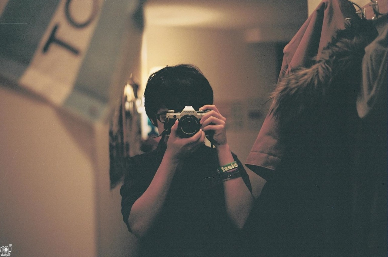Self portrait with my AE-1. I regret selling it off. | New York, NY.