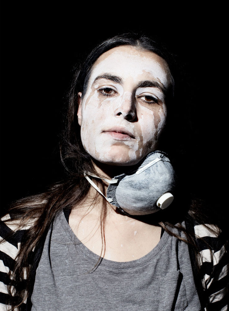 Greek protester Katerina Patrikarakou covers her face in a Maalox mixture to counter the effects of tear gas.