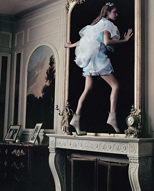 leahcultice:  Natalia Vodianova in 'Alice in Wonderland' photographed by Annie Leibovitz for Vogue US December 2004 Through the Looking Glass: Wrapped in ocean-blue Balenciaga couture, Alice perched on the mantel, longing to escape into the shadow world, as her black kitty purred nearby.