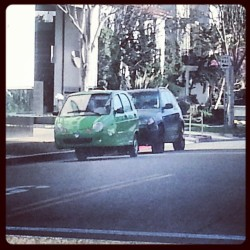 Three wheeled car?!?!? #wtf #threewheeledcar #weird #probablyanenvironmentalist #green #concept #photooftheday #odd #weord #unique