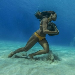 builttobulk:  onlyfitgirls:  Ha'a Keaulanaruns across the ocean floor with a 50 pound boulder. They do this as training to survive the massive surf waves of winter. She learned her amazing skills from her dad, legendary waterman #briankeaulana and her Grandpa, #Buffalo. I was very humbled to learn from the Hawaiians who have salt water running through their veins. Mahalo Nui Loa. Please stay tuned for our upcoming story on the Hawaiian surfing culture. Shared of @natgeo  This is just.. Super impressive.