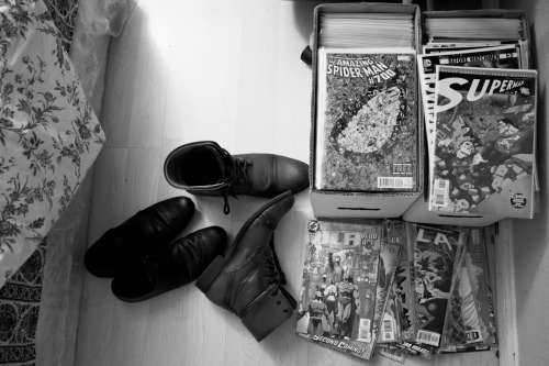 Boots, blankets, boxes of books (comic books).