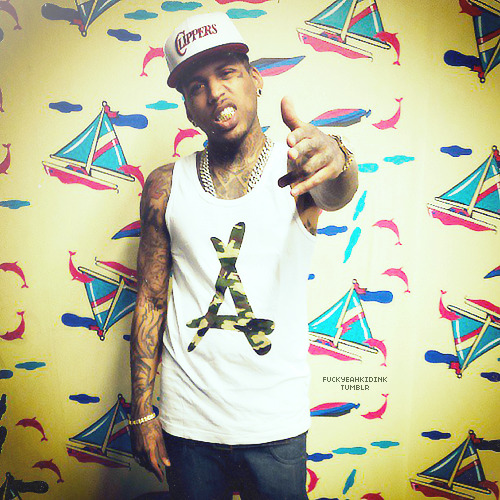 "Ink stoppin' by ""Pink Dolphin Clothing"" store before he hit the road."
