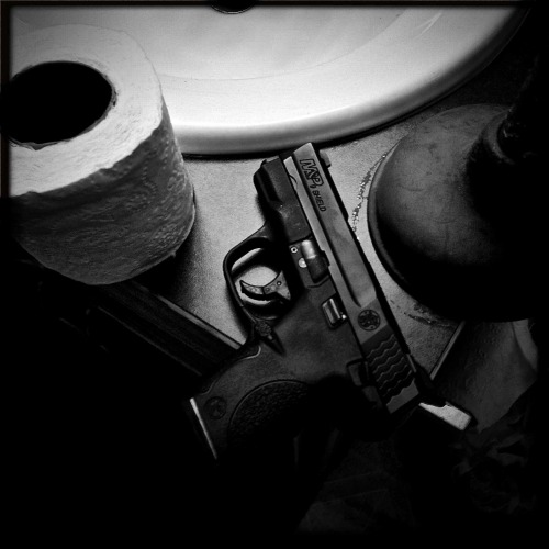 """M&P Shield""  For your daily dose of Hipstamatic this image of my M&P 9mm shield.  I never go anywhere with out it. Check it out at my blog http://www.hipstamaticpics.com Hipstamatic 261. John S lens, Black Keys film"