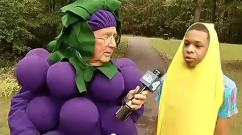 Reporter wears grape costume to defend boy suspended for banana suit
