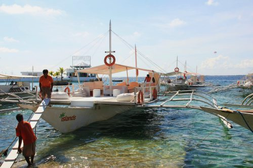 Island Hopping in Cebu, Philippines When going to Cebu, never miss island hopping. Cebu has some of the most beautiful islands in the world! To make your experience more memorable, hire one of Islands Banca Cruises' boats. This is the chicest bangka I've ever seen! All white, with clean beanbags and orange towels free for use. They even sell snacks on board. To top this all off, you can hook up your ipod on their sound system! Instant party under the sun while sailing along the blue-est waters I've ever seen! Do NOT miss this when you go to Cebu! :)