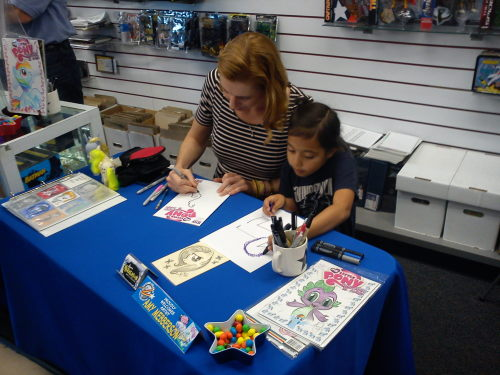 thingsamylikes:  Drawing Rarity: SRS BUSINESS  Me and a baby fan at Flying Colors comics yesterday. She'd brought her own markers and said she wanted to draw with me.  Why I love her… Your awesome Amy ;)