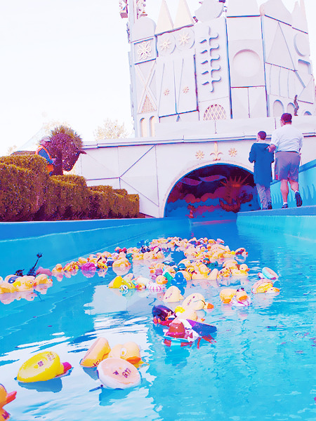 "fancysomedisneymagic:  RUBBER DUCK RACE AT DISNEYLAND PARK Hundreds of rubber ducks raced around the world for a cause at the 5th annual ""it's a small world"" duck race! Cast members sponsored and decorated the ducks to raise more than $1,800 for Make-A-Wish Orange County and the Inland Empire before Disneyland park opened for the day on May 13th. The cast fundraiser carries forward the attraction's legacy of supporting children, dating back to the 1964-1965 New York World's Fair when it was created in honor of the United Nations Children's Fund (UNICEF). Cast members waited anxiously to see which rubber duck would race through ""it's a small world"" fastest. Source: Disney Parks Blog"