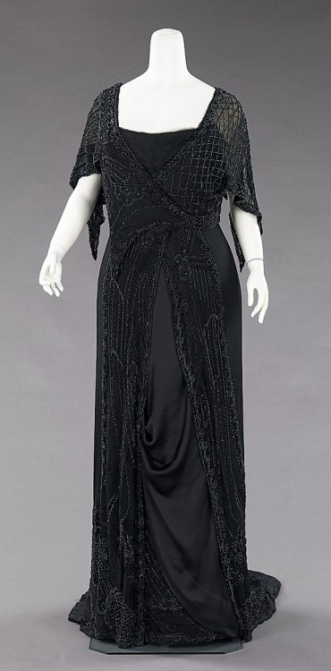 Mourning dress by Charlotte Duclos, ca 1910 France, the Metropolitan Museum of Art I usually don't like mourning dresses (you weren't supposed to, anyway), but the beading pattern on this one is stunning.  The elaborate but subtle beading on this mourning dress would have shimmered when new. The asymmetry of the charmeuse panel is indicative of the high fashion of the period. An example of extremely chic mourning attire for the evening, it features an element of subtle exposure: the beaded underpanel hidden by the charmeuse would have been revealed with the movement of the wearer.