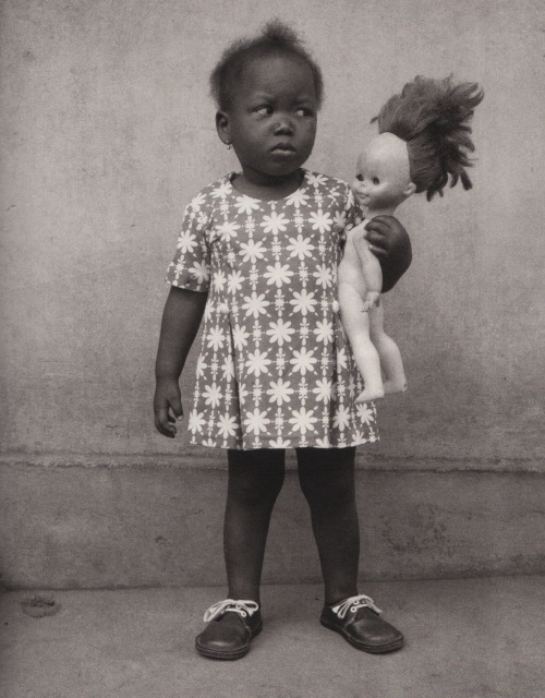 "Edouard Méhomé : A Fon child (Studio photo Vedette, Porto-Novo, Benin). From ""Life and afterlife in Benin"" edited by Alex Van Gelder, Phaidon, 2005."