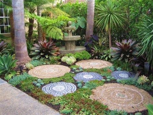 Moroccan mosaic with bromeliads by Green Landscapes to Envy, Costa Mesa, California.
