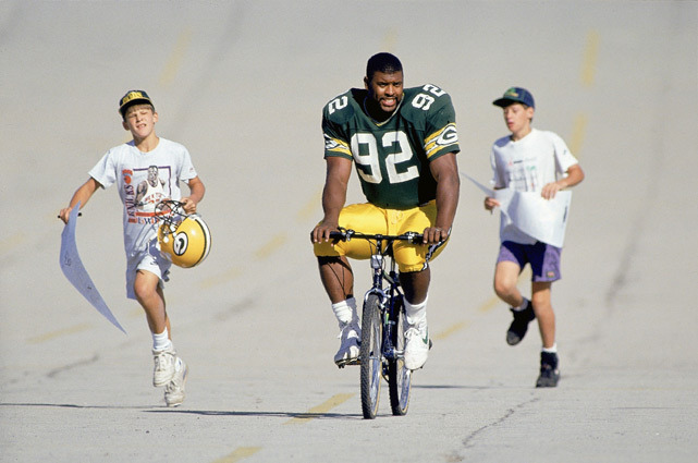 Packers DE Reggie White is chased by fans during 1993 Packers training camp at St. Norbert College in De Pere, Wisc. (John Biever/SI) GALLERY: Rare Photos of Reggie White