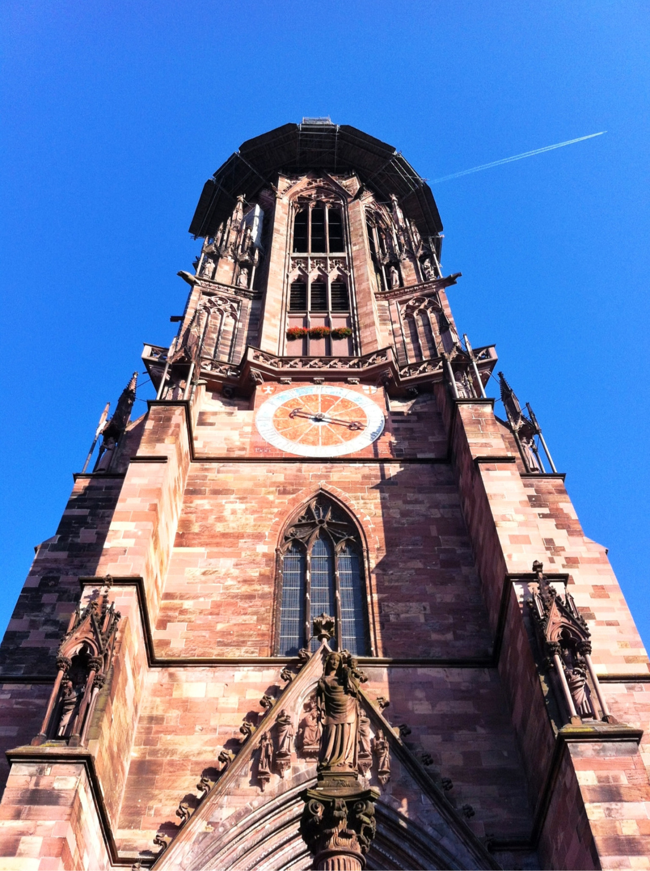 "Jacob Burckhardt, a Swiss historian, said that the bell tower of the Freiburg Münster ""will forever remain the most beautiful spire on earth"".  It is really impressive, but I'll let you decide if it's the most beautiful. It's a little difficult to just because the bell tower is being restored.  A better view of the spire can be seen on my photography site but the top is still shrouded in scaffolding.  Taken with Click! App, processed with Snapseed."