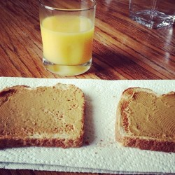 Breakfast this am. Getting my #Jesus fix today :) #oj #toast #peanutbutter #sunday #me