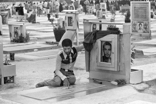 An Iranian man prays at the grave of his brother who was killed during the Iran-Iraq War (Picture by Kaveh Golestan)