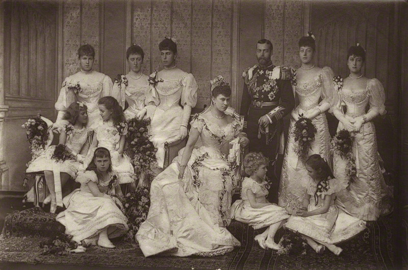 thestuffoffairytales:  George V and Queen Mary with their Bridesmaids. Bridesmaids:  Patsy (Princess Patricia of Connaught) Daisy (Princess Margaret of Connaught) Ducky (Princess Victoria Melita of Saxe-Coburg and Gotha) Sandra (Princess Alexandra of Hohenloe-Langenburg) Alice of Battenberg (later Princess Andrew of Greece and Denmark - Prince Philip's mother) Ena (Princess Victoria Eugenie of Battenberg - later Queen of Spain) Maud (Princess Maud - later Queen of Norway) Toria (Princess Victoria of the United Kingdom) Baby Bee (Princess Beatrice of Saxe-Coburg and Gotha)  Thora (Princess Helena Victoria of Schleswig-Holstein). by W. & D. Downeycarbon print, 6 July 1893  Two of the bridesmaids would later marry into the Spanish Royal Family, Ena to King Alfonso XIII and Baby Bee to the Infante Alfonso de Orléans y Borbón (Ali)