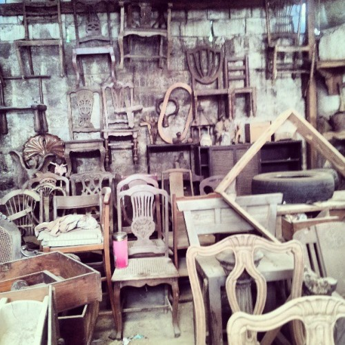 Rustic chairs, from floor to wall. (at Anna's Antiques)