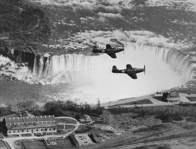 A pair of lend-lease P-63s flying over Niagara Falls at some point in 1943.