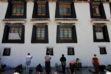Prostrating monks at Lhasa's Jokhang Temple  by  ◄ccdoh1►