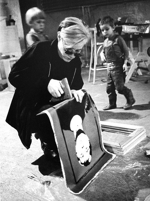 Andy Warhol working on a self-portrait in The Factory, 1964.