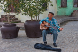 "Guantanamera Old Singer plays and sings Guantanamera at the Plaza del Carmen in Camagüey. ""Guantanamera"" (Spanish: ""from Guantánamo"", thus ""woman from Guantánamo"") is perhaps the best known Cuban song and that country's most noted patriotic song. Canon EOS 40D1/250sISO 400f/9.9 Camagüey,Cuba Flickr - Twitter - Facebook - Google+ - Posterous - 500px Copyright © BorisJ Photography - Boris Jusseit - all rights reserved - please do not use this image on any media without my permission."