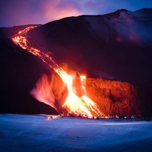 "‎""Cars line up in the path of lava flowing down the Eyjafjallajkull volcano in Iceland."" Amazing. Though probably wouldn't be my first reaction to a lava flow: go park the car in front of it, get out for a better look."