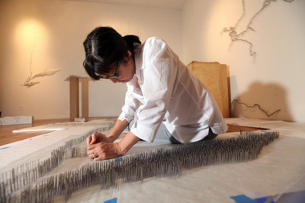 "The New York Times highlights, Maya Lin, the architect and artist, and her current exhibit at Pace, ""Here and There,"" which opens to the public TONIGHT, April 27th, from 6-8 pm at our 57th Street gallery.  We hope you can attend!   Credit: Chester Higgins Jr./The New York Times"