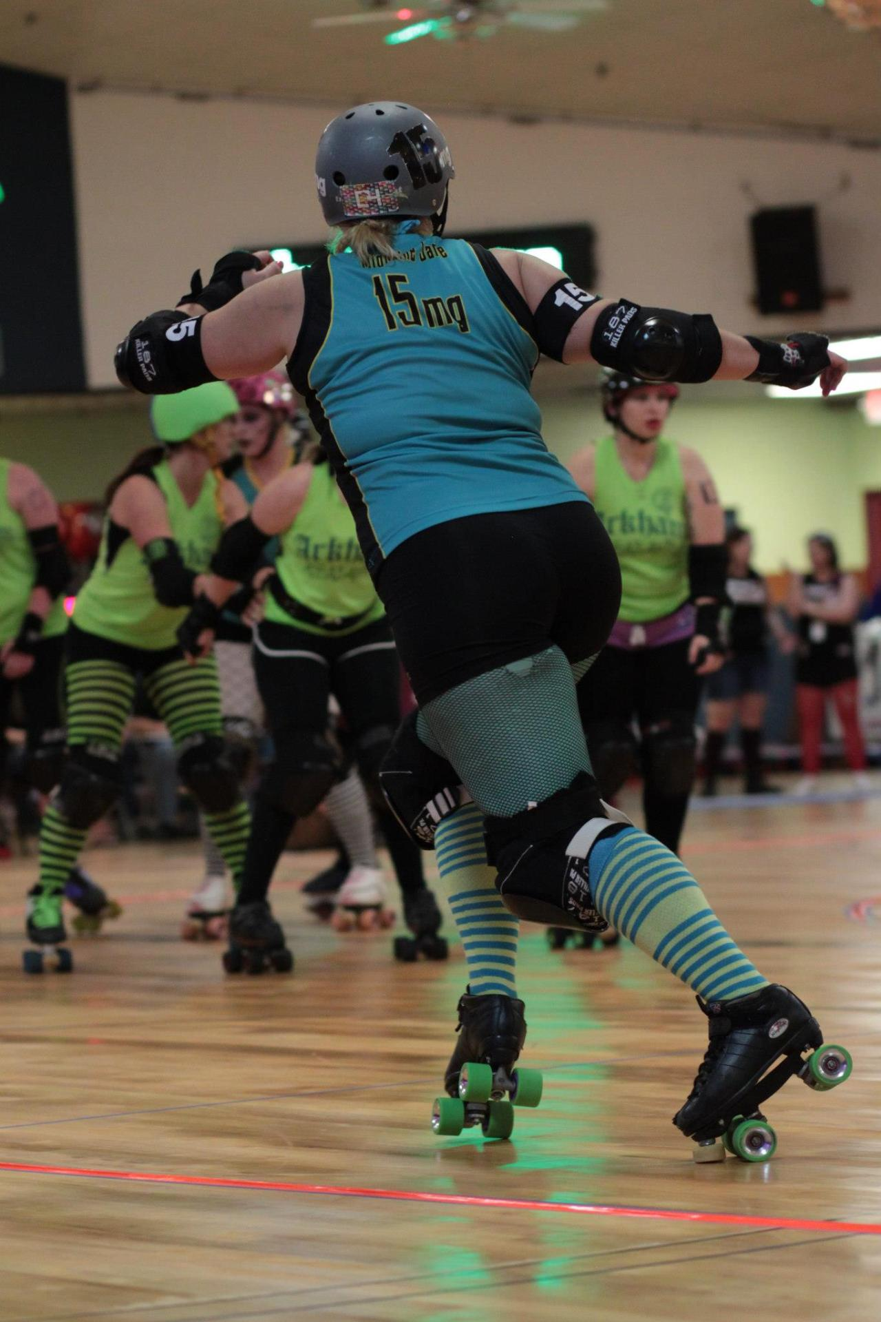 Migraine Jane #15mg at the Arkham Assailants vs Sunnyland Slammers bout. 2.10.13 Photo Credit: Canonball