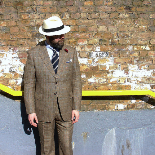 giantbeard:  BritishBespoke   A little Winter sun has given me all the excuse I need to break out my new summer suit, cut by John DeBoise at Cad & the Dandy. Made up with a classic, structured shoulder, roped sleeve head, deep vents & generous, yet proportional, lapels & pocket flaps. Cut from a handsome, lightweight, Prince of Wales check cloth, in a slubby linen & silk mix that I found in a fabric warehouse visited last year with Gerald & Diana of Vanda Fine Clothing, who, incidentally, made this tie for me.