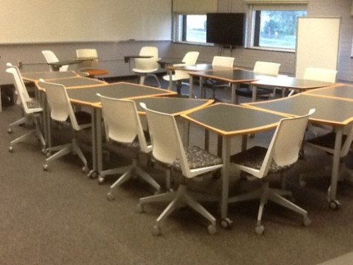 "New flexible classroom design breaks out of rigid row-column design - Researchers at North Carolina State University have developed a classroom design that gives instructors increased flexibility in how to teach their courses and improves accessibility for students, while slashing administrative costs. The new flexible approach acknowledges the fact that students are now bringing their own laptops to class. The classrooms also include mobile infrastructure, where whiteboards, desks and tables can be reconfigured according to the needs of students and instructors. ""These classrooms work really well in terms of engaging students, particularly in regard to helping students bridge the gap between in-class instruction and out-of-classroom assignments,"" says Dr. Susan Miller-Cochran, an associate professor of English and director of the First-Year Writing Program at NC State and lead author of a paper on the flexible classroom design. The flexible design also improves access for students with special needs. This approach could also lead to more creativity and active involvement by students, replacing the centuries-old, mind-numbing passive lecture format. Would this also improve some working environments? — Editor (via New flexible classroom design breaks out of rigid row-column design 