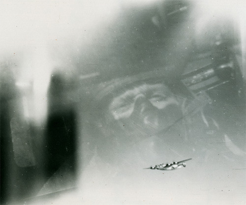 "The View from the Tail Turret  ""When Eighth Air Force gunner Art Krieger turned his camera on one of the other Consolidated B-24 Liberators in his squadron's formation, he probably didn't realize he was making a self-portrait. Swathed in heavy flight gear, his oxygen mask firmly in place in the thin air at an altitude of 20,000 feet, Krieger's own face squints back at us, reflected in the shiny Plexiglas of the big bomber's tail turret.."" (via)"