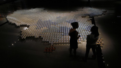 """Chinese artist Ai Weiwei has unveiled his latest work, a map of China made from baby formula tins, in response to fears surrounding milk safety in ChinaMay 17, 2013 Weiwei, whose 81 days of detention in 2011 sparked international outcry, has regularly criticized the government for ignoring the rule of law and the rights of Chinese citizens. In his latest work, the dissident artist has arranged more than 1,800 large tins of milk powder from seven popular brands in the shape of a huge map of China. Fears about milk safety were reignited in 2008 when at least six children died and 300,000 fell ill after drinking milk formula laced with industrial melamine. Since the scandal many Chinese parents have taken to importing milk powder from foreign countries. Weiwei said: """"A country like this can put a satellite into space but it can't put a safe bottle teat into a child's mouth. I think it's extremely absurd. This is a most fundamental assurance of food, but people actually have to go to another region to obtain this kind of thing. I think it's a totally absurd phenomenon."""" The """"milk map"""" has gone on display in Hong Kong, which had to restrict the amount of milk powder brought back to mainland China after parents flocked to the former British colony to stock up. More than 30 million mainland Chinese visited Hong Kong last year, almost four times the city's population, causing concern about the ability of the city's infrastructure to cope. Complaints of milk powder shortages and rocketing prices were also reported. Speaking in response to the Chinese """"run"""" on Hong Kong's milk supply, Weiwei said: """"I have heard of drug trafficking before, but when a country has milk powder smuggling instead of drug smuggling, I think this is a devastating sign."""" The Chinese government has tried to reassure people that milk powder and dairy products in China are now safe and rigorously tested, but lax regulatory enforcement remains a problem. In 2004, at least 13 babies in the central Anhui pr"""