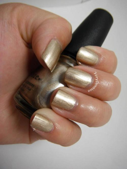 verydennieenails:  China Glaze - Passion (2 coats) Shiny metallic gold.  Great for nail art!