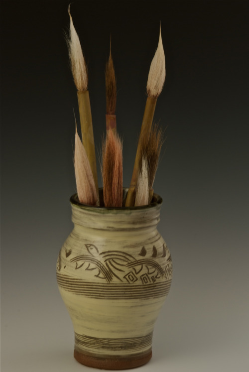 Stoneware vase. White slip with incised drawing.