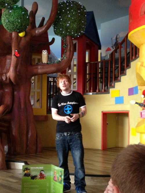 sheerannosaurus-eds:  justedsheeran:  Ed Sheeran at LEGOLAND (X)  This is his heaven right?