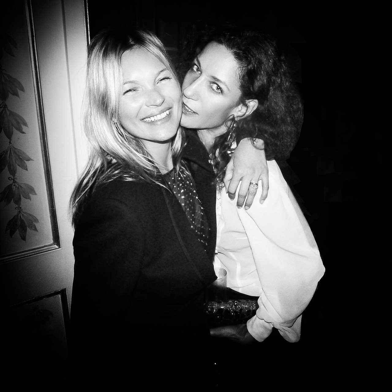 "Kate Moss & Mapressa Hennink just seconds before the ""famous"" kiss at Carine Roitfeld's party in Paris. Photo by German Larkin"