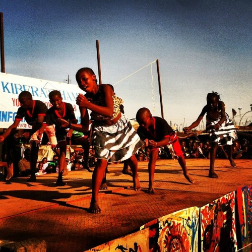 Kibera Hamlets kids performing on stage at the Kibera Walls for Peace inaugural event. We got a great crowd!
