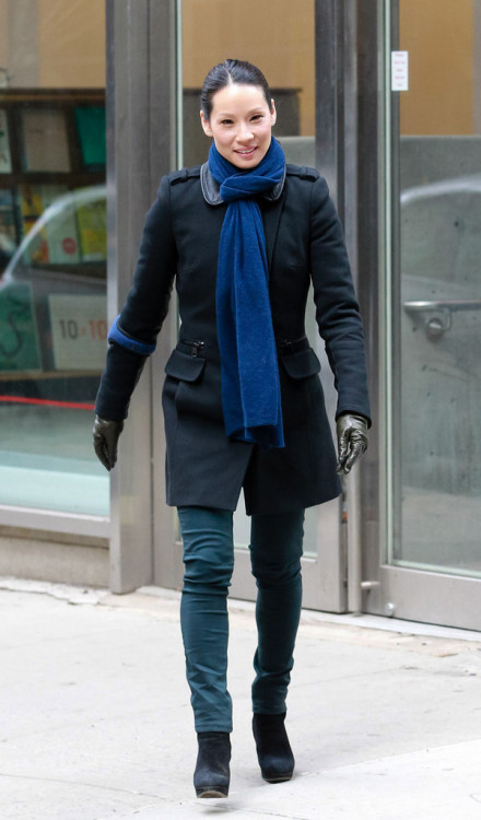 Lucy Liu tries to keep warm in a tied scarf and leather gloves as she continues filming scenes for Elementary (Feb 20)