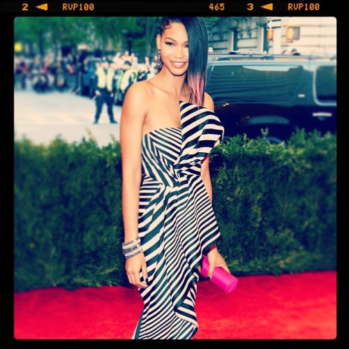 Holy moly. How much do I LOVE @chaneliman's look from the #MetGala?! #Stripes #pinkhair and an Amanda Pearl roll clutch!