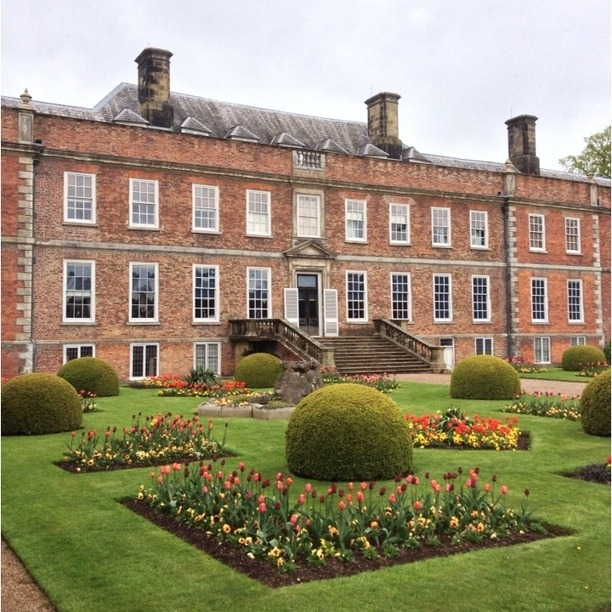 Erddig Hall is a National Trust property on the outskirts of Wrexham, Wales. Located 2 miles south of Wrexham town centre, it was built in 1684–1687 for Joshua Edisbury, the High Sheriff of Denbighshire. It was the home to the Yorke family until is was bequeathed to the NT in the late 70s. Erddig is unusual in that the family treated the staff very well and took photographs of them and wrote poems about them. Erddig focuses on servant life and is a refreshing change from the usual way that the NT present their properties.  Discovered at Erddig, Erddig, Wales. See more at Trover