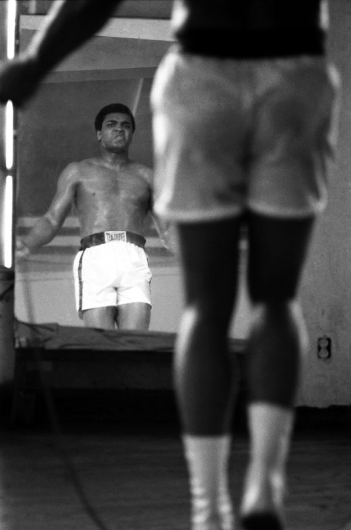 life:  Muhammad Ali watches himself in the mirror while jumping rope in 1971 — Photographer John Shearer recalls the 'Fight of the Century' between Ali and Frazier. (John Shearer—Time & Life Pictures/Getty Images)